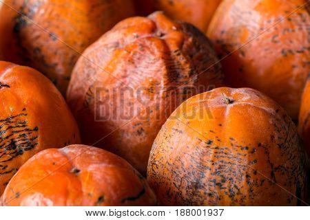 Exotic tropical fruit persimmon, autumn harvest, sweet fruit