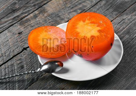Exotic tropical fruit persimmon, autumn harvest, sweet fruit
