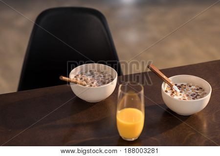 Breakfast At Home With Orange Juice And Corn Flakes With Milk