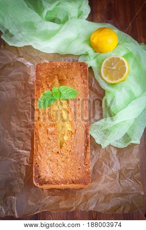 Lemon Pound Cake With Mint On Wooden Background