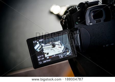 BASEL SWITZERLAND - APR 28 2017: View through video camera camera electronic display to a luxury Zenith swiss made watch during the photography advertising campaign shooting