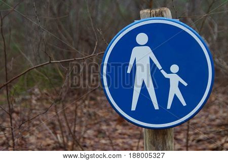 Dutch pedestrian road sign - Footpath- against a forrest background