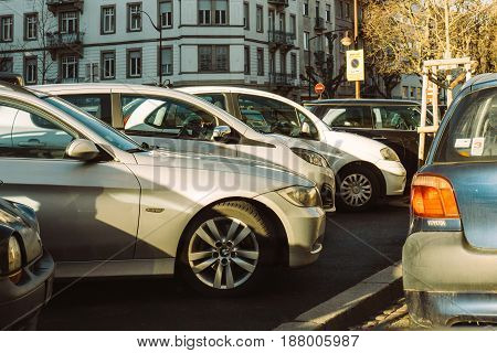 STRASBOURG; FRANCE - MAR 2; 2017; Rows of cars parked in city on a full parking lane