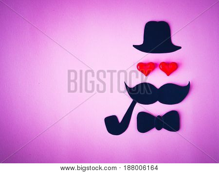 Father's day concept. black paper of dad face and Mustache on pink background