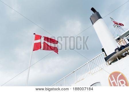 HUNDESTED DENMARK - AUGUST 8 2016: Danish flag on the Hundested - roervig ferryboat