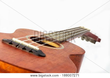 Brown ukulele Hawaiian guitar isolated on white background.