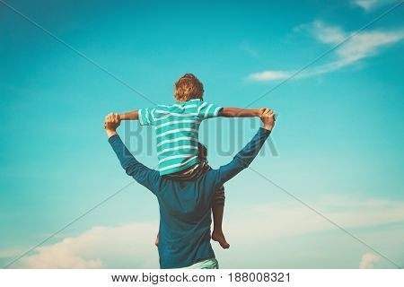 father and little son having fun on sky