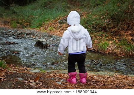 Ambitious Young Child Looking At The Stream Flowing