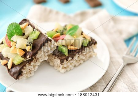 Delicious crispy dessert with chocolate and fruits on plate