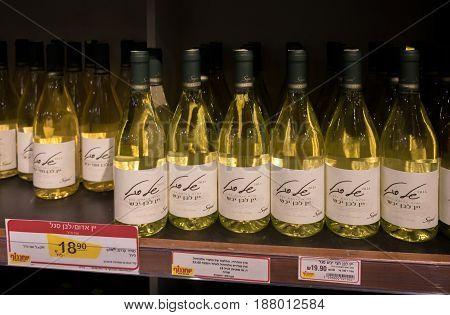 Rows Of Israeli Wine Bottles For Sale On Shelf At Food Supermarket