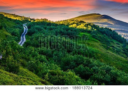 Countryside Road In Mountains At Sunrise