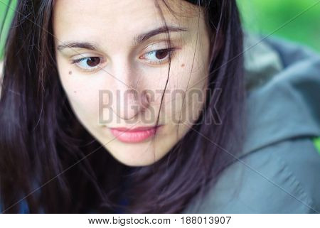Young beautiful girl without makeup with beautiful black eyes and dark long hair.