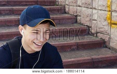 Stylish teenager in headphones listening to music