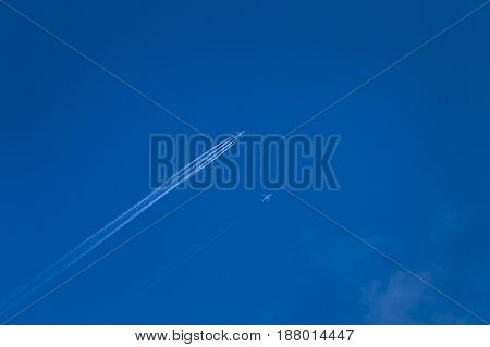 Overtaking Airplane On Blue Sky