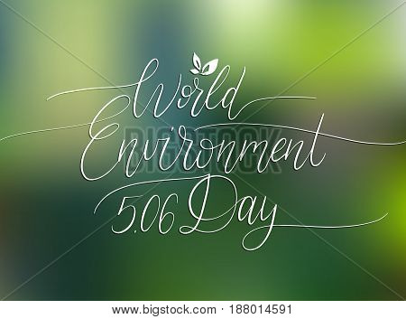 World environment day hand lettering for card, poster. Vector calligraphic illustration on blurred background