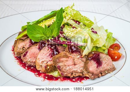 Tasty, Appetizing Pieces Of Chopped Meat With Sauce, Tomatoes And Herbs, On A White Plate. Horizonta