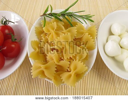 Farfalle noodles cocktail tomatoes and mozzarella balls
