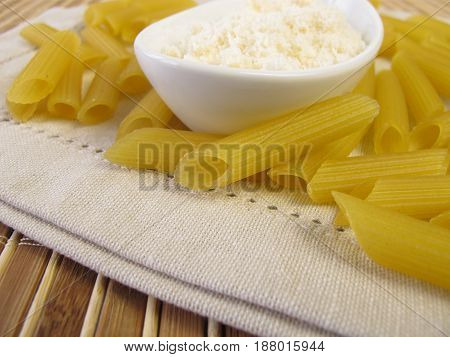 Gluten free penne pasta and grated cheese