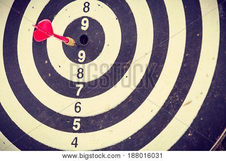 Red Dart Arrow Hitting In The Dartboard