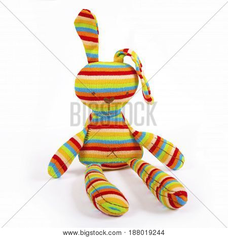 Funny striped rabbit fabric toy isolated on white.