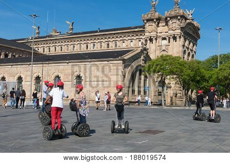 Statue Of Christopher Columbus Pointing America, Touristst Travel By Segway. Barcelona, Spain