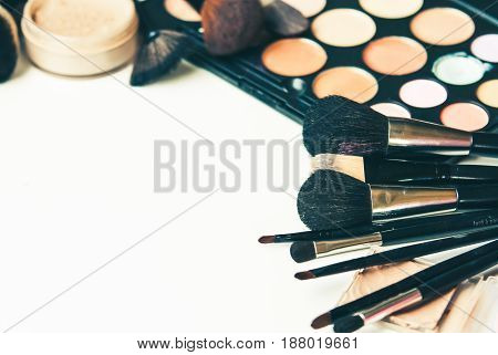 palette of cosmetics for naked make up with professional brushes