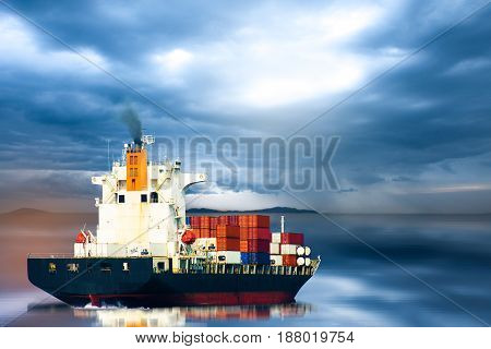 Container ship in ocean on storm sky / selective focus.