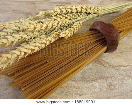 Whole grain linguine and ears of wheat