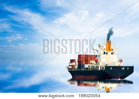 Container ship in ocean and on blue sky / selective focus.