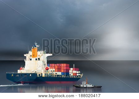 ship with international container on storm sky.