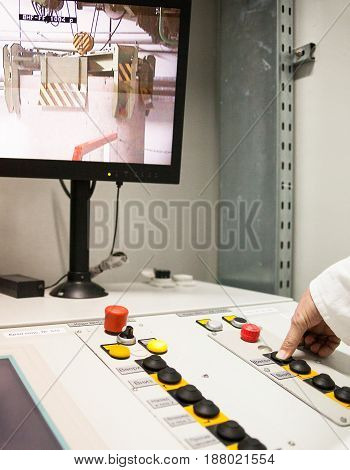 CHERNOBYL UKRAINE - OCTOBER 16 2015: Engineer monitoring nuclear reprocessing in a control room at Chernobyl Nuclear Power Plant.