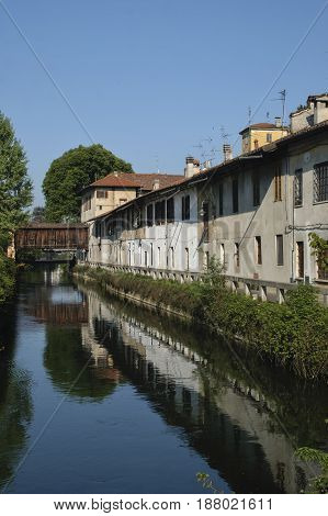 Gorgonzola (Milan Lombardy Italy): old houses along the Martesana canal with wooden bridge and bicycle lane