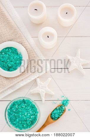 Spa Composition With Candles, Sea Salt And Flowers On White Wooden Background. Flat Lay.