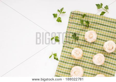 Fresh Champignon And Parsley On White Background. Flat Lay.