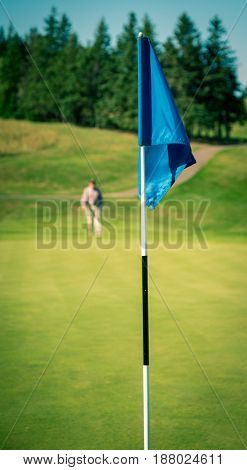 Golfer approaches the green in Prince Edward Island