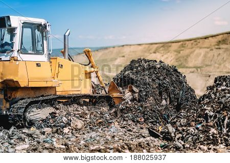 Yellow Bulldozer Moving Garbage With Scoop. Industrial Construction Details