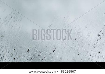 cool rain drops on window in rainyday