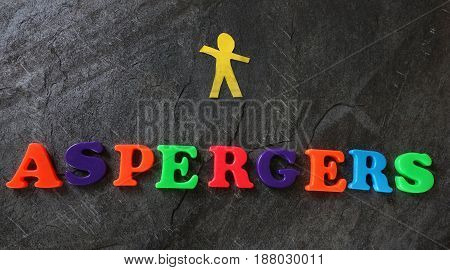 Aspergers spelled out in colorful letters with paper cutout