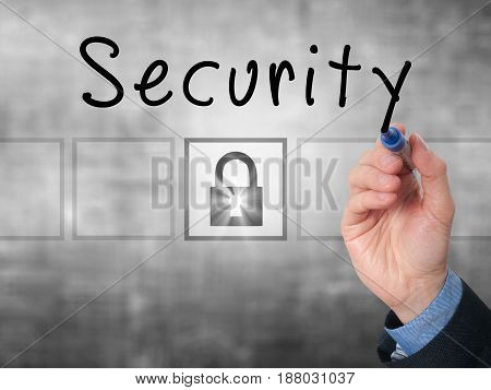 Businessman Hand Writing Security On Transparent Board