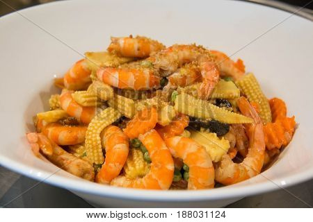 Close-up of colorful stir fry of shrimp and clolorful Vegetables Thai food.