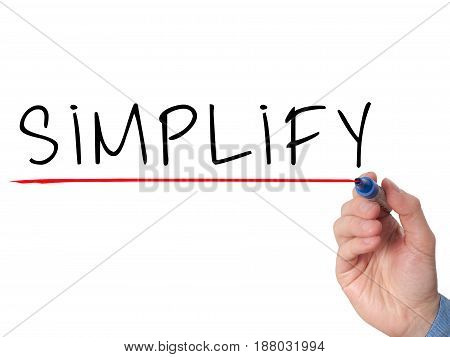 Businessman Hand Writing Simplify With Marker On Transparent Wipe Board Isolated On White