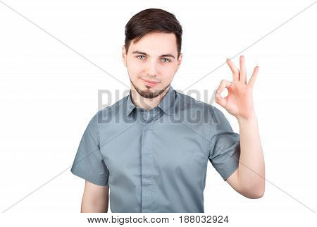 Cheerful Young Man Showing Ok Gesture. Man Showing Ok Sign Over White Background. Handsome Business