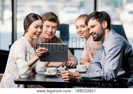 Business Team On Meeting Discussing Project With Digital Tablet In Cafe, Business Lunch Concept