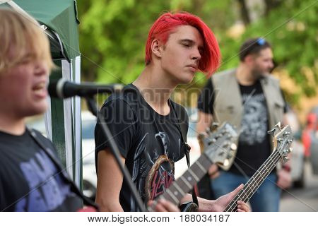 VILNIUS LITHUANIA - MAY 20: Unidentified musicians play guitars in Street Music Day on May 20 2017 in Vilnius. Its a most popular event on May in Vilnius Lithuania