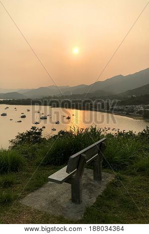Silhouette Of Fishing Boat, Outdoor Chair, Mountain And Sun