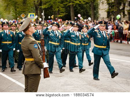 RUSSIAN KOZELSK MAY 9 2017 Victory Day May 9. Military Parade on anniversary of Victory in Great Patriotic War. Soldiers marching show at mass celebrations people