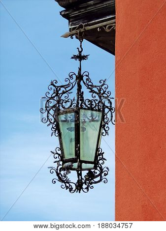 Ancient twisted lantern hanging on the sky background
