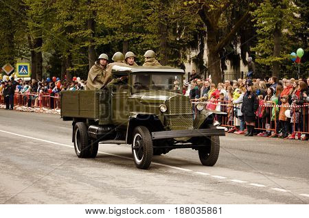 RUSSIAN KOZELSK MAY 9 2017 Victory Day May 9. Military Parade on anniversary of Victory in Great Patriotic War. Old truck GAZ-AA. Retro military vehicle With Re-Enactors Dressed As Soldiers