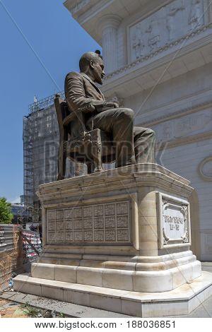 SKOPJE, REPUBLIC OF MACEDONIA - 13 MAY 2017: Hristo Tatarchev Monument and Macedonia Gate arch, Skopje, Macedonia