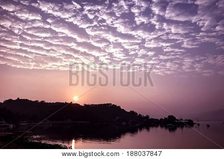 High Cumulus Cloud, Gradient Sky And Lake At Sunrise